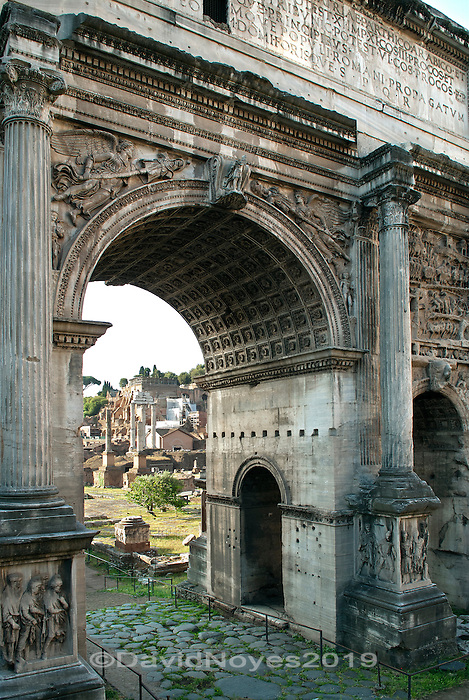 Originally raised on a travertine base, the Arch of Septimius Severus stands at the northeast end of the Roman Forum is a triumphal arch dedicated in AD 203 to commemorate the victories against the Parthians in 194/195 and 197-199.