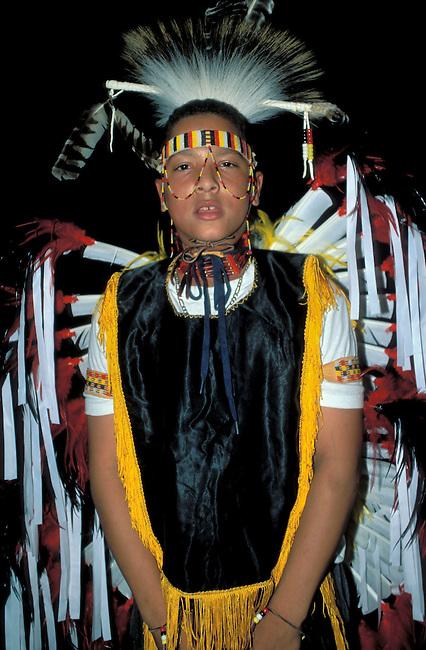A Nanticoke fancy dancer dressed in pow wow regalia attends a dance presentation at the Nanticoke Indian Museum in Millsboro Delaware