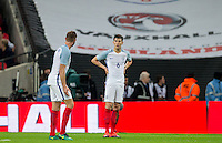 Jordan Henderson (Liverpool) of England appears to direct blame at John Stones (Man City) of England after the first spain goal during the International Friendly match between England and Spain at Wembley Stadium, London, England on 15 November 2016. Photo by Andy Rowland.