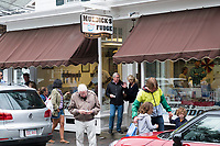 People walk past Murdick's Fudge on North Water Street in Edgartown, Martha's Vineyard, Massachusetts, USA. Other companies on Martha's Vineyard and around the US had difficulty obtaining H2B visas, but Murdick's Fudge received all it requested.