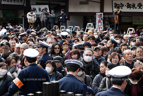 Policemen patrol between visitors during a Setsubun festival at Naritasan Shinshoji Temple on February 3, 2016, in Chiba, Japan. Setsubun is an annual Japanese festival celebrated on February 3rd and marks the day before the beginning of Spring. Celebrations involve throwing soybeans (known as mamemaki) out of the house to protect against evil spirits and into the house to invite good fortune. In many Japanese families one member will wear an ogre mask whilst others throw beans at him or her. The celebration at Naritasan Shinshoji Temple is one of the biggest in Japan and organizers this year expect over 50,000 people to attend the event. Each year famous sumo wrestlers and actors are also invited to participate in throwing the beans. (Photo by Rodrigo Reyes Marin/AFLO)