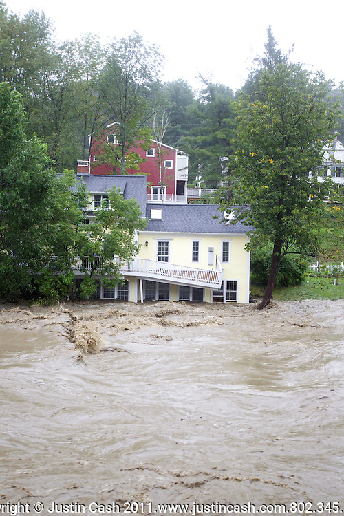 The Ottauquechee River cresting it's banks in Woodstock and Quechee, Vermont.  August 28, 2011.