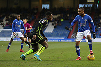 Oldham Athletic's Gevaro Nepomuceno (c) watched by Bristol Rovers' Marc Bola (left) and Billy Bodin (right) during the Sky Bet League 1 match between Oldham Athletic and Bristol Rovers at Boundary Park, Oldham, England on 30 December 2017. Photo by Juel Miah / PRiME Media Images.