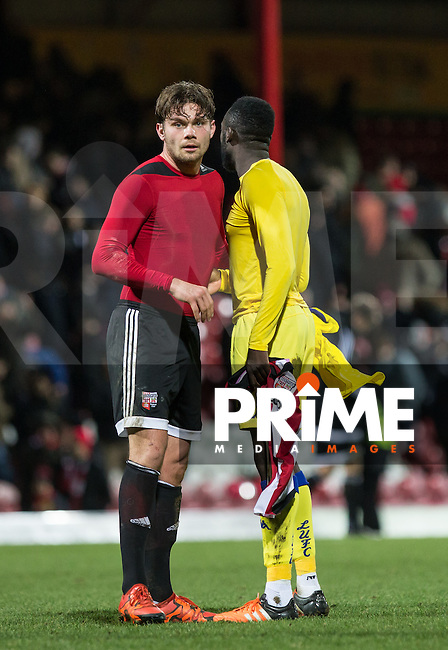 Harlee Dean of Brentford swops shirts with Toumani Diagouraga of Leeds United during the Sky Bet Championship match between Brentford and Leeds United at Griffin Park, London, England on 26 January 2016. Photo by Andy Rowland / PRiME Media Images.