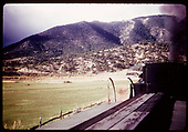 View from caboose roof of a D&amp;RGW freight train in the distance at an undetermined location.  The D&amp;RGW freight engine appears to be a K-37 (#490-#499).<br /> D&amp;RGW    ca. 1947-1951