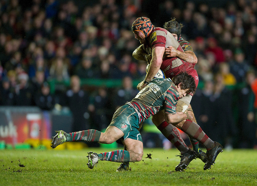 Gloucester's Ben Morgan is tackled by Leicester Tigers' Anthony Allen ..Rugby Union - Aviva Premiership - Leicester Tigers v Gloucester - Saturday 29th December 2012 - Welford Road - Leicester....