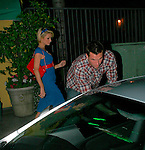 3-2-09.Monday Night .Paris Hilton leaving Dan Tana's restaurant in Hollywood with new boyfriend Doug Reinhardt .  Paris was wearing a red and blue dress ....AbilityFilms@yahoo.com.805-427-3519.www.AbilityFilms.com