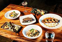 Dishes and interior dinning area at El Five restaurant in Denver, Colorado, Wednesday, October 18, 2017. Dishes include patatas bravas, lamb ribs, crispy cauliflower Yufka, shrimp & calamari a la plancha and a Spanish scaffa cocktail.<br /> <br /> Photo by Matt Nager