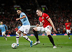 Riyad Marhez of Manchester City faces a tired looking Phil Jones of Manchester United during the Carabao Cup match at Old Trafford, Manchester. Picture date: 7th January 2020. Picture credit should read: Darren Staples/Sportimage