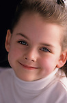 Young girl ( 7 years old) portrait, smiling at camera, Lake Pleasant, Bothell, Washington State USA    MR