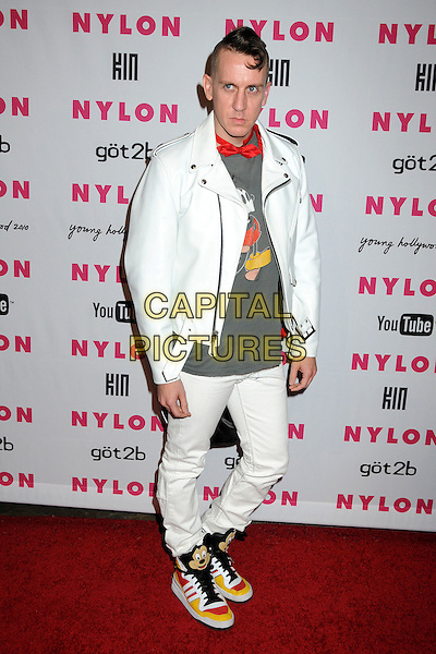 JEREMY SCOTT .Nylon Magazine's Young Hollywood Party held at the Roosevelt Hotel's Tropicana Bar, Hollywood, California, USA..May 12th, 2010.full length white jeans denim leather jacket grey gray top hi top tops disney  Mickey mouse tongue hi-tops hi-top trainers red bow tie.CAP/ADM/BP.©Byron Purvis/AdMedia/Capital Pictures.