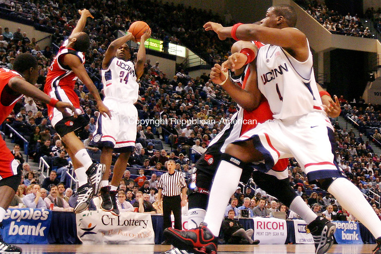 HARTFORD, CT. 03 February 2007-020307SV04--#24 Craig Austrie of UConn puts up a shot against Rutgers during basketball action at the Hartford Civic Center in Hartford Saturday.<br /> Steven Valenti Republican-American