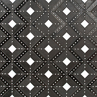 Beaton, a hand-cut and waterjet stone mosaic, shown in honed Orpheus Black, Nero Marquina, Shell, and tumbled Thassos, is part of the Bright Young Things™ collection by New Ravenna.