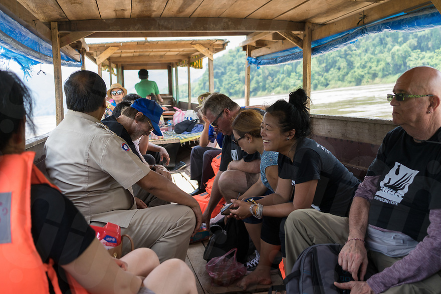 May 9, 2017 - Luang Prabang (Laos). Channapha Khamvongsa,  and a delegation from Legacies of on the boat to visit the village. © Thomas Cristofoletti / Ruom