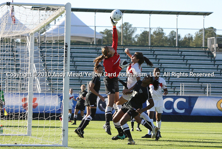 07 November 2010: Wake Forest's Aubrey Bledsoe (in red) makes a save. The Wake Forest University Demon Deacons defeated the University of Maryland Terrapins 3-1 on penalty kicks after the game ended in a 1-1 tie after overtime at WakeMed Stadium in Cary, North Carolina in the ACC Women's Soccer Tournament championship game.