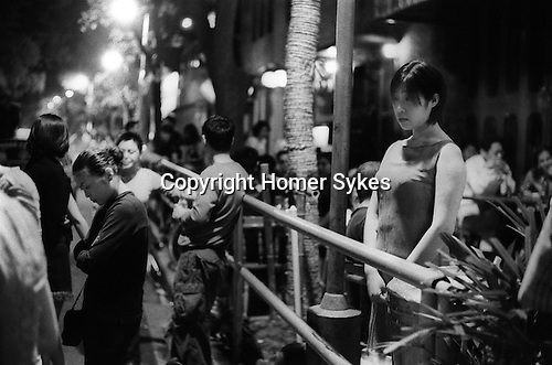 China, Shanghai.  A balmy summers night outside Judys Too in Mao Ming Lu. Local girls go to meet expatriates, and expatriates go to meet local girls and dance the night away.  The action starts around midnight.