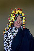 Woman wearing amber, Kham, Eastern Tibet, 2006