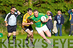 Denis Walsh(Emmets) and John McCarthy(Finugue) in O'Sullivan Park last Saturday evening.