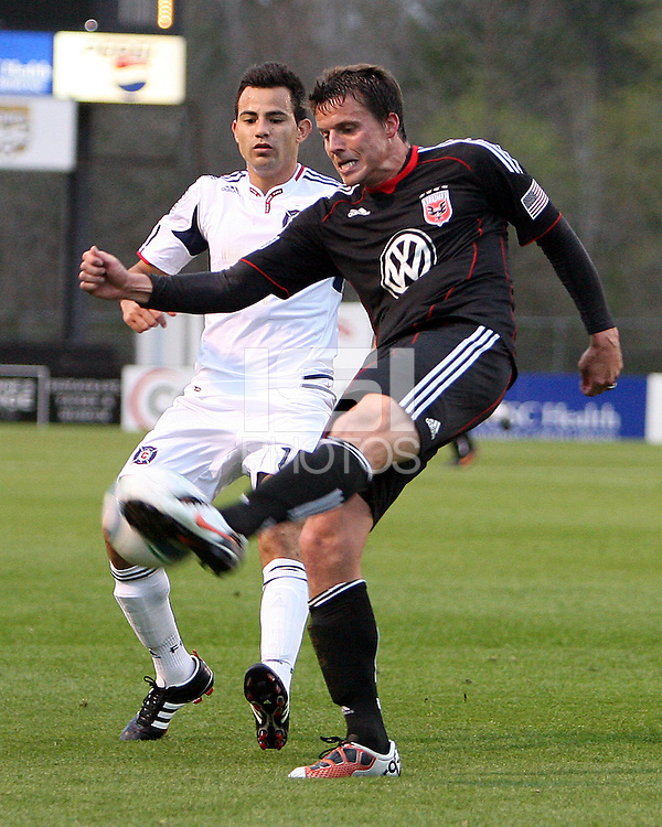 Mark Burch#4 of D.C. United kicks the ball away from Marco Pappa#16 of the Chicago Fire during a second round match of the Carolina Challenge on March 9 2011 at Blackbaud Stadium, in Charleston, South Carolina. D.C. United won 1-0.