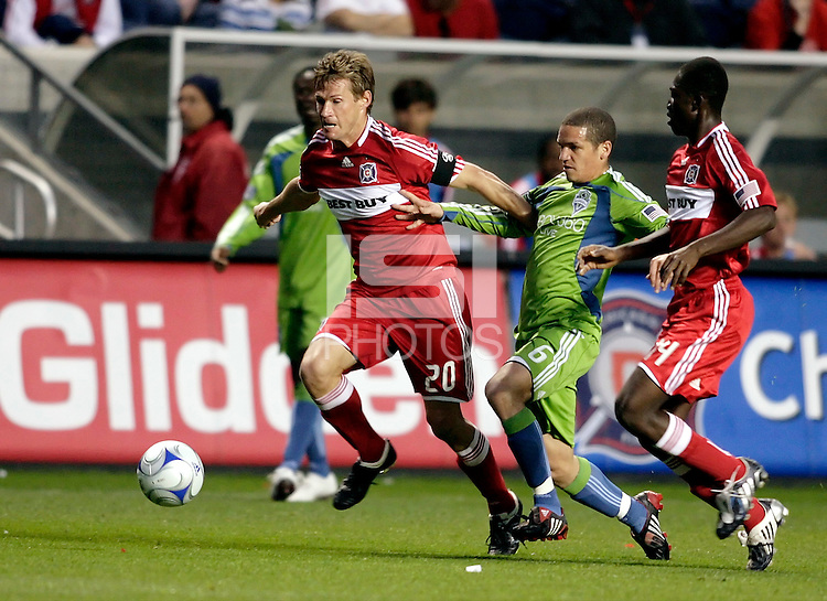 Chicago Fire forward Brian McBride (20) breaks away from Sounders FC midfielder Osvaldo Alonso (6).  The Chicago Fire tied the Seattle Sounders FC 1-1 at Toyota Park in Bridgeview, IL on May 2, 2009.