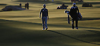 Late evening sunshine across the undulations on the 18th with Emiliano Grillo (ARG) walking in during the practice round before the 2014 Alfred Dunhill Links Championship, The Old Course, St Andrews, Fife, Scotland. Picture:  David Lloyd / www.golffile.ie