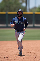 Seattle Mariners first baseman Eric Filia (15) rounds the bases on a home run hit by Geoandry Montilla (not pictured) during an Extended Spring Training game against the San Francisco Giants Orange at the San Francisco Giants Training Complex on May 28, 2018 in Scottsdale, Arizona. (Zachary Lucy/Four Seam Images)