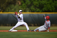 Dartmouth Big Green second baseman Justin Fowler (25) throws to first as Sean Kennedy (10) slides in during a game against the Ball State Cardinals on March 7, 2015 at North Charlotte Regional Park in Port Charlotte, Florida.  Ball State defeated Dartmouth 7-4.  (Mike Janes/Four Seam Images)