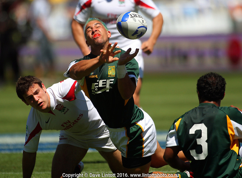 Adam Vardey fires a pass away during Cook Islands' defeat of England..NZI Wellington Sevens, Day One. Round one. Westpac Stadium, Wellington. 1 February 2008. Photo: Dave Lintott / lintottphoto.co.nz