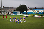 Home players celebrating as Port Talbot Town (in blue) score their third goals against Caerau Ely in a Welsh Cup fourth round tie at the Genquip Stadium, formerly known as Victoria Road. Formed by exiled Scots in 1901 as Port Talbot Athletic, they competed in local and regional football before being promoted to the League of Wales  in 2000 and changing their name to the current version a year later. Town won this tie 3-0 against their opponents from the Welsh League, one level below the welsh Premier League where Port Talbot competed, watched by a crowd of 113.