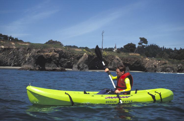 A kayaker enjoying a sunny day at  Big River, Mendocino California