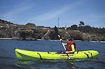 A kayaker enjoying a sunny day at  Big River, Mendocino California