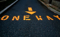 One Way directions painted in yellow on a street in Hoboken, New Jersey