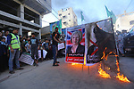 """Palestinian supporters of Hamas movement burn a poster of British Prime Minister Theresa May during a protest against the 100th anniversary of Britain's Balfour Declaration in Gaza city on November 3, 2017, which helped lead to Israel's creation and the Israeli-Palestinian conflict. Palestinian president Mahmud Abbas used the occasion to denounce the declaration, writing in a newspaper opinion piece that """"the creation of a homeland for one people resulted in the dispossession and continuing persecution of another"""". Photo by Mohammed Asad"""