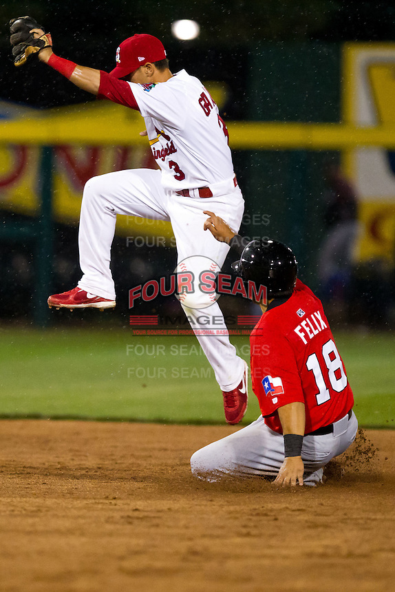 Jose Garcia (3) of the Springfield Cardinals jumps over Jose Felix (18) of the Frisco RoughRiders to end the game against the Frisco RoughRiders on April 14, 2011 at Hammons Field in Springfield, Missouri.  Photo By David Welker/Four Seam Images.