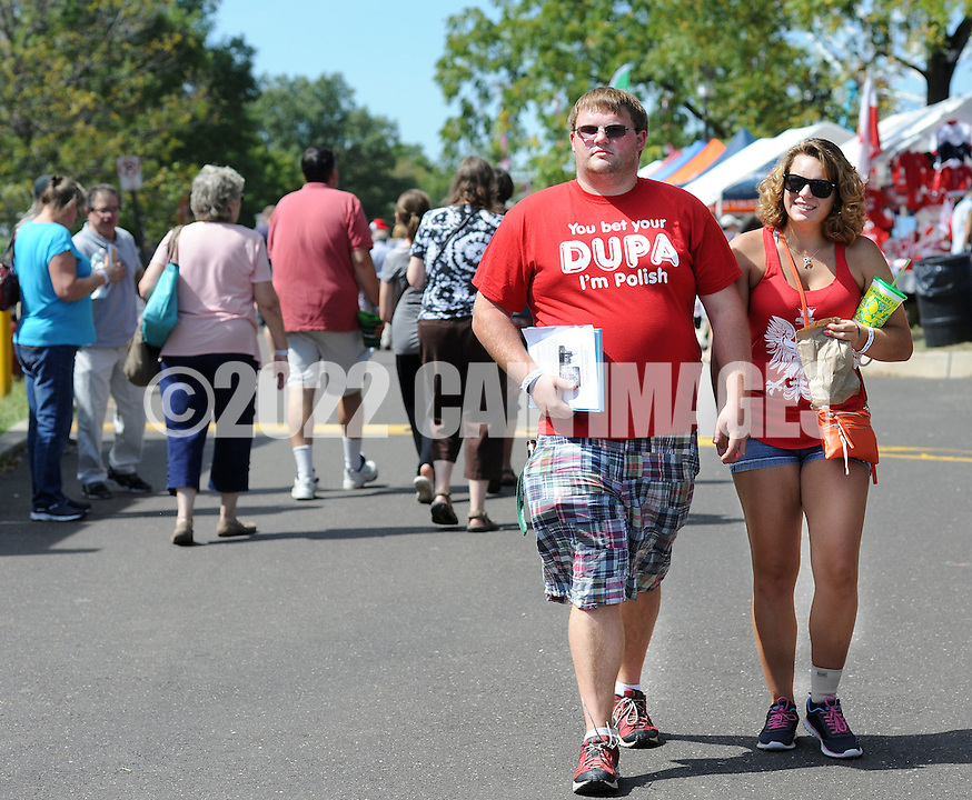 PSHRINE07P<br /> Edward Fronkweicz (L) of Farmingdale, New York and Jessica Oszvart of Robbinsville, New Jersey walk through the 50th annual Polish American family festival and country fair at the National Shrine of Our Lady of Czestochowa Sunday September 6, 2015 in Doylestown, Pennsylvania.  (William Thomas Cain/For The Inquirer)