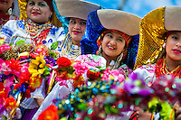 Woman dancers (danzantes) take part in the religious parade within the Corpus Christi festival in Pujilí, Ecuador, 1 June 2013. Every year in June, thousands of people gather in a small town of Pujili, high in the Andes, to celebrate the Catholic feast of Corpus Christi. Introduced originally during the Spanish conquest of South America, this celebration merges Catholic rituals of Holy Communion with the traditional Andean harvest and sun festivities (Inti, the Inca sun god). Women dancers perform wearing brightly colored costumes while men dancers wear chest ornaments and heavy elaborate headdresses adorned with mirrors, jewelry, or natural items (shells). Being a dancer in the Corpus Christi ceremonial parade (El Danzante) is considered an honour and a privilege by the indigenous people in Ecuador.