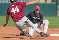 Hawgs Illustrated/BEN GOFF <br /> Jax Biggers, gray team shortstop, tries to tag out Derek Ripp of cardinal team Wednesday, Oct. 11, 2017, during the Arkansas baseball Fall World Series scrimmage at Baum Stadium in Fayetteville.