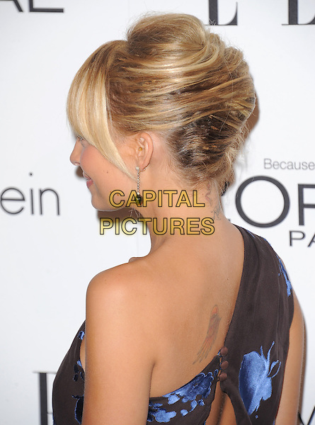Nicole Richie Madden.18th Annual ELLE Women in Hollywood celebration held at The Four Seasons in Beverly Hills, California, USA..October 17th, 2011.headshot portrait brown blue print one shoulder floral print back side profile chignon french twist.CAP/RKE/DVS.©DVS/RockinExposures/Capital Pictures.