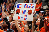 Virginia fans hold up a sign during the game Sunday in Charlottesville, VA. Virginia defeated Maryland in overtime 61-58. Photo/Andrew Shurtleff