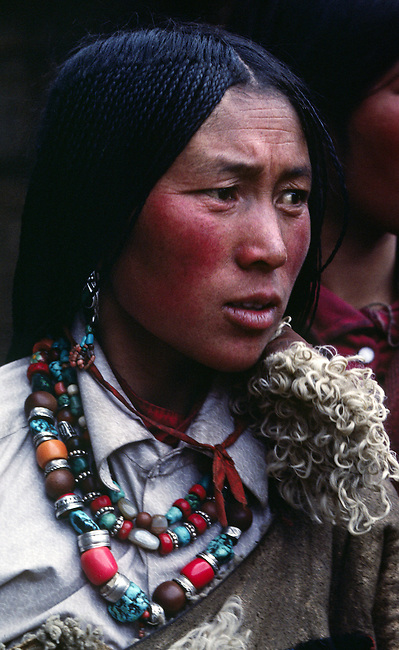 Tibetan pilgrim woman with beautiful jewelry & traditional 108 braids at Sera Monastery - Lhasa, Tibet