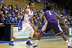 26 November 2014: Duke's Tyus Jones (5) and Furman's John Davis III (1). The Duke University Blue Devils hosted the Furman University Paladins at Cameron Indoor Stadium in Durham, North Carolina in a 2014-16 NCAA Men's Basketball Division I game. Duke won the game 93-54.