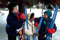 Friends age 10 thru 15 preparing to ski and snowboard. St Paul Minnesota USA