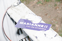 Campaign buttons and stickers lay on a fence as people wait for the arrival of Democratic presidential candidate and spiritual guru Marianne Williamson before she speaks to a small crowd in the back yard of Kathleen O'Donnell at a campaign house party event in Keene, New Hampshire, on Wed., May 22, 2019.