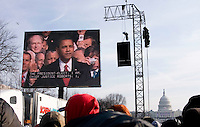 Spectators watch on giant outdoor screens as Barack Obama is sworn in as the 44th president of the United States of America, Tuesday, Jan. 20, 2009, in Washington, D.C. (Heather Halstead/pressphotointl.com)