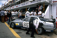 LE MANS, FRANCE: The Porsche 924 Carrera GTR driven by Manfred Schurti, Patrick Bedard and Paul Miller is checked in the pit lane before practice for the 24 Hours of Le Mans on June 20, 1982, at Circuit de la Sarthe in Le Mans, France.