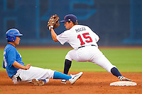 Andrew Maggi #15 of Team USA forces out a runner from Team Korea to complete a double play at Durham Bulls Athletic Park July 18, 2010, in Durham, North Carolina.  Photo by Brian Westerholt / Four Seam Images