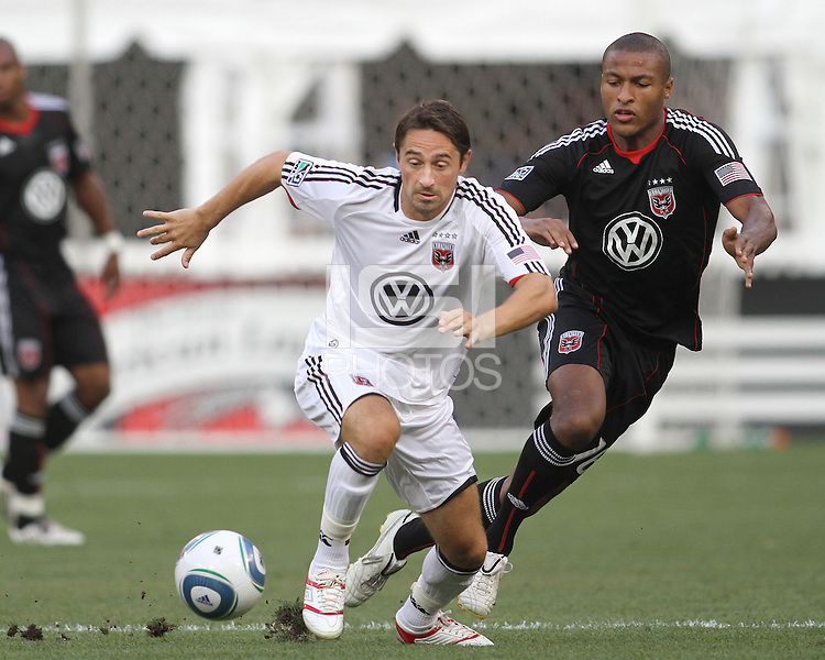 Jordan Graye #16 of D.C. United moves in on Nadir Citfci #99 of Portsmouth FC during an international friendly match at RFK Stadium on July 24 2010, in Washington D.C. United won 4-0.