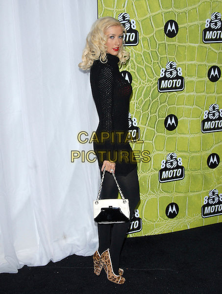 CHRISTINA AGUILERA.The 8th Annual Motorola Anniversary Party held at The Palladium in Hollywood, California, USA. .November 2nd, 2006.Ref: DVS.full length red black crochet knitted dress see through thru bra dress purse bag leopard print shoes .www.capitalpictures.com.sales@capitalpictures.com.©Debbie VanStory/Capital Pictures