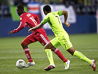Chicago Fire forward Patrick Nyarko, left, dribbles the ball past Seattle Sounders FC defender James Rileyduring play between the Seattle Sounders FC and the Chicago Fire in the U.S. Open Cup Final at CenturyLink Field in Seattle Tuesday October 4, 2011. Seattle won the game 2-0 to win its third U.S. Open Cup.