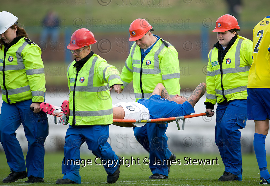 Cowdenbeath's Lewis Coult is carried off  ...